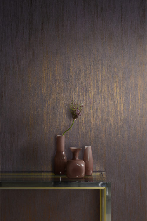 Detail of the stunning Elixir wallcovering in mauve with bronze foil. A nice setting with 3 different vases and metal table.