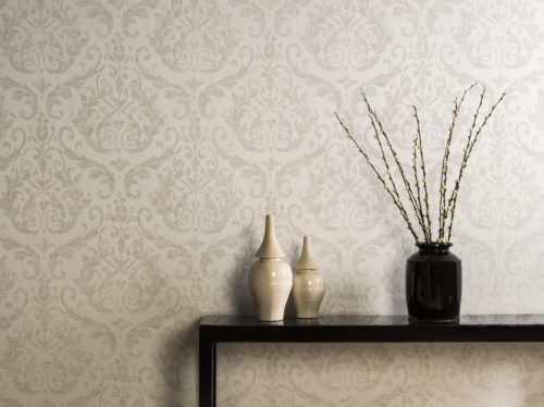 Regal interior picture of damask wallcovering in soft ones, branch with catkins and ivory coloured pots.