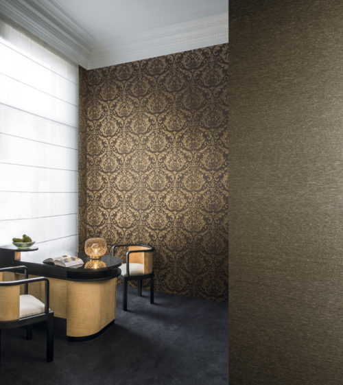 Classic feel room with a desk or bar and two seats. Two dark brown Omexco wallcoverings on the walls. One golden damask, one plain.