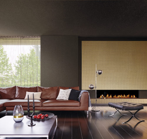 Warm living room with fireplace and two types of mica wallcoverings from the Omexco Graphite range. Sumptuous brown leather couch, low coffee table, black leather stool.