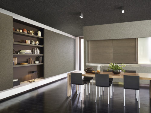 Contemporary kitchen with mica wallcoverings from the Graphite range. Wooden table with black chairs. In one of the walls shelves are hidden. Sliding doors.