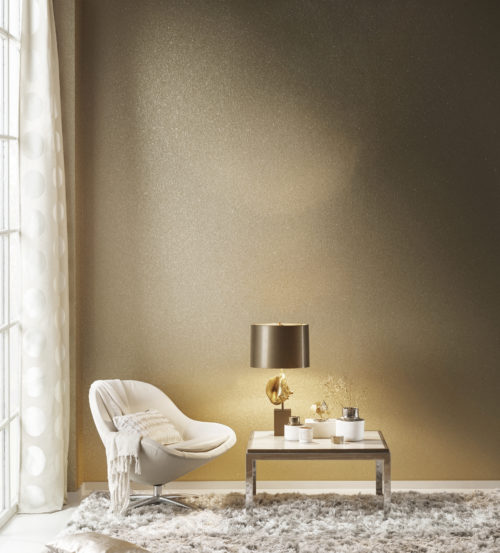 Stunning mica shells wallcovering. Mother of pearl in old gold reflecting the light from a lamp with brown shade. Contemporary white lounge chair, curtain with large dots and plush carpet.