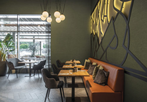 On the walls of this cosy, contemporary restaurant: the Abaca design in moss green from Omexco's High Performance Textures collection. It's a semi plain non-woven wallcovering with an intriguing texture, shown horizontally. Woven extra fine abaca. The abaca fibre we use as a grasscloth in Seraya and other collections is the inspiration.  It is the stem and supporting structure of the long leaves of the Abaca tree, a species of banana tree native to the Philippines.