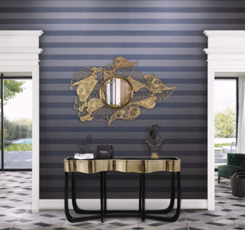 Hallway of a house with a pool. Eyecatches are the dark blue striped Infinity wallcovering and the filigree golden mirror.