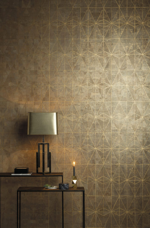 The celeste design from our Khatam wallcovering collection: ancient star inlay design evoking the elegance of gold leaf. A candle makes the gold foil shimmer.