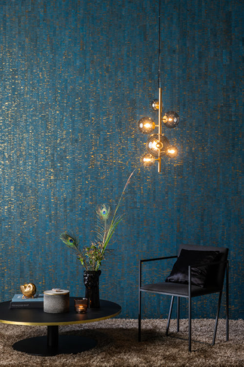 The Omexco Khatam collection: a timeless collection of contemporary neutral tones and shades contrasted with striking jewel colours. In this picture: peacock blue. Intimately connected with nature, the Khatam collection is authentic, elegant and entirely suited to modern living.