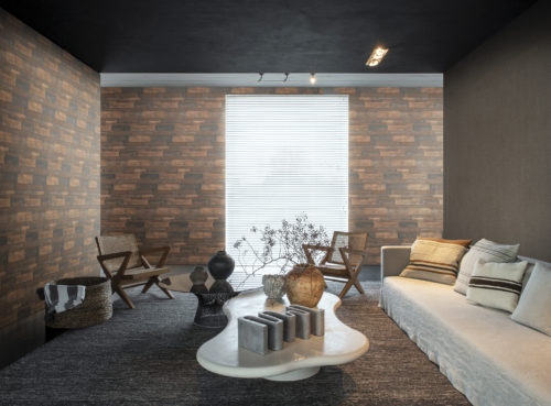 Impressive interior with ethnic details. On the walls: a horizontally installed wallcovering from our Loft collection. The walls look like oxidised metal. We see a wooden chairs, white recycled sofa, large assymetrical coffee table and woven basket.