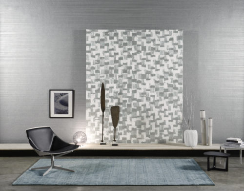 Detail of RAA202 wallcoverings from the Omexco Rainbows collection. Squares of crushed paper, in silver and white. Behind it a plain wallcovering from the same range.