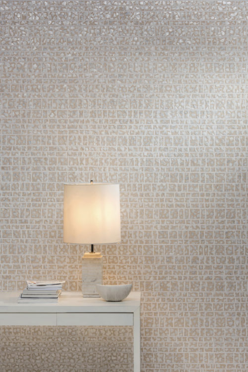 Wall showing of the capiz wallcovering from the Shades of Pale collection. The mother-of-pearl in the wallcovering goes well with the white lamp.