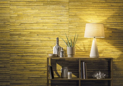 Dedicated to the finest artisan traditions, Omexco transforms pure materials into exceptional wallcoverings, from natural elements into works of art. Banana bark, coconut bark, rattan, bacnoc, waterlily, capiz,... In this picture we see the bright yellow waterlily wallcovering in all it's splendour.