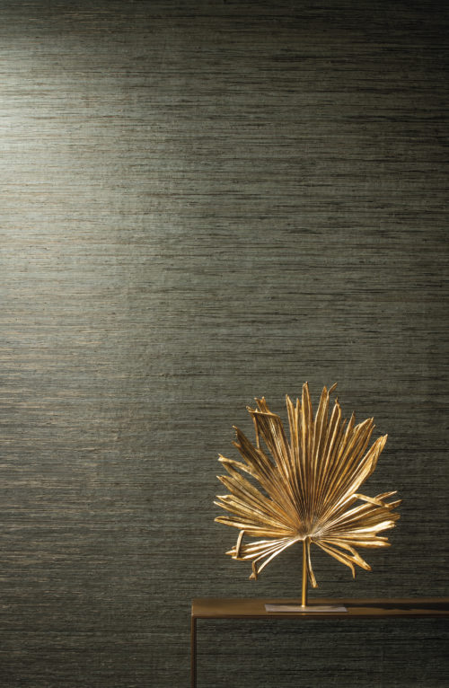 Raffia threads wallcovering from our Seraya collection in this close up: the raffia is delicately coloured in layered pastels or lacquered effects and laminated onto non woven paper. The collage is laid out on a metallic background, evocative of precious minerals.