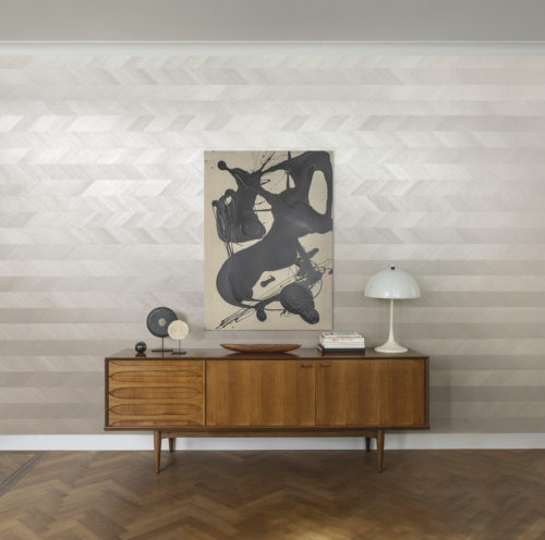 This detailed picture shows just how timeless and elegant our chevron design from our Sycamore collection is. We suggest a railroad hanging here. Sycamore exclusive wallcoverings: soft glamour reflecting our desire for a deeper connection with nature.