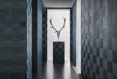 The Sycamore collection by Omexco is uniquely defined by a celebration of natural wood.  Our elegant and refined wallcoverings bring to life this noble and authentic material. We see a well lit hallway presenting the blue 'chess' design: squares of wood in different direction like a chess board.