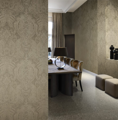 This picture is an example of how Omexco can dress your walls in absolute luxury. The Shalimar damask in taupe colour makes the walls of this dining room stand out.