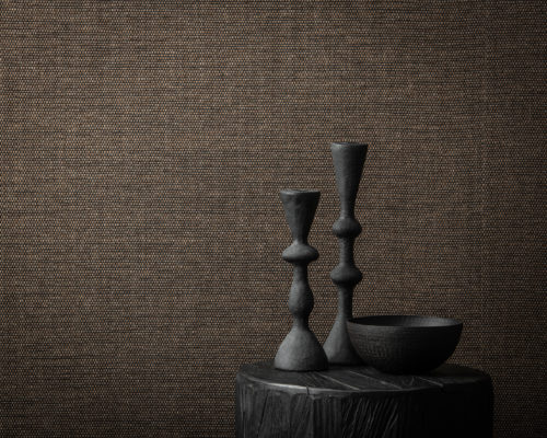 Serene subtil plain from Omexco's paperweave collection Tribu. We see a closeup of the design Duo, a beautifully simple weave in shades of charcoal and chocolate.