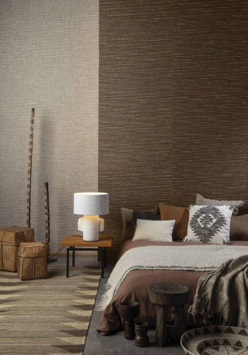 Tribu by Omexco is a contemporary collection of woven wallcoverings that honours ancestral weaving traditions from Asia to Africa. Satisfy your desire for multicultural modernism and timeless design. The beige and brown paperweave wallcoverings in this ethnic bedroom whisper luxury.