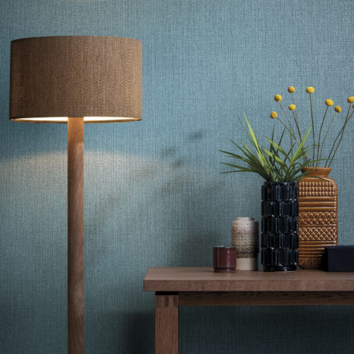 Colour contast between the blue from the Aruba wallcovering and ocre lamp and vases.