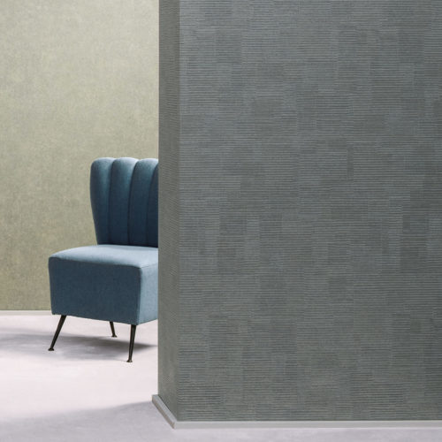 A blue chair hides behind a wall of Bijou all over square effect wallcovering.