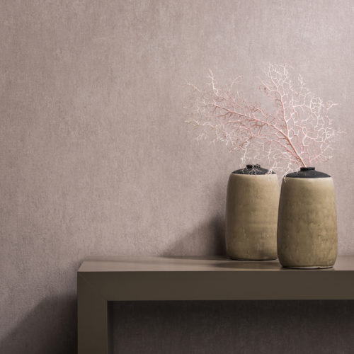 How beautiful pink can be: Borneo wallcovering in soft pastel pink. In harmony with sepia side board. Two decorative vases, one with a pink branch.