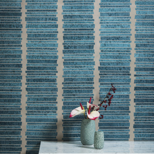 This wallcovering has been made by craftsmen. They've made a vertical collage of bright blue paperstrips to form this wallcovering.