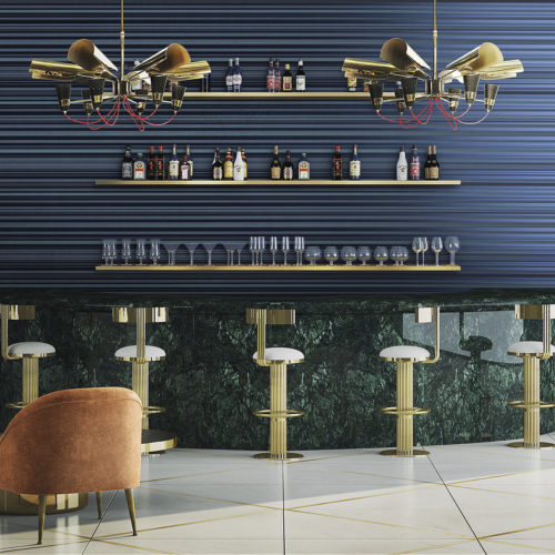 Green marble bar with golden bar stools. Two eyecatching golden lamps with red electric cords. Glasses and bottles behind the bar. Blue striped Infinity wallcoverings.