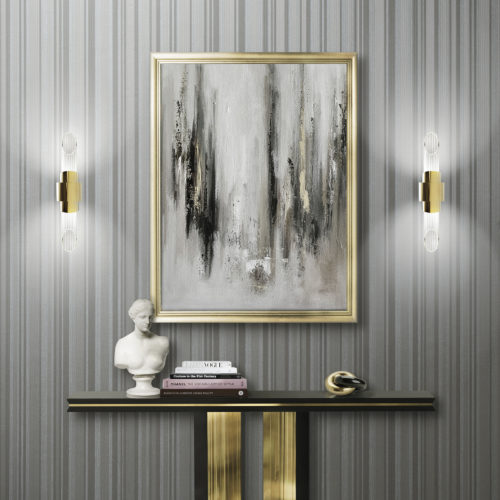 Impressive golden Beyond console by Luxxu. On the consule a buste and a few books. Misty painting. The two Tycho wall lights bring out the Infinity wallcovering.