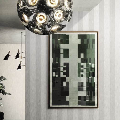 Outstanding chrome pendant lamp by Delightfull. Abstract painting. Striped Infinity wallcoverings in light and dark grey.