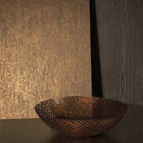 Little decor with shades of brown: dark tropical wood, copper bowl made out of rings, gold reflecting Kaleidoscope wallcovering.