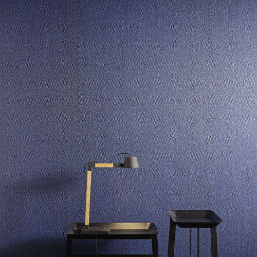 """Kami means """"paper"""" in Japanese, and Ito """"strip"""" - Kami-ito is the Japanese art to realize thin paper strips, which are subsequently woven into delicate and creative paper weaves. The wallcovering collection Kami-ito, signed Omexco, consists mainly of paper strips. The variation of weaves and patterns makes it possible to create interesting and colourful interior settings, natural and bright. In this interior detail we see the night blue paper strips wallcovering combined with a black chair, blue pillows and reading light."""