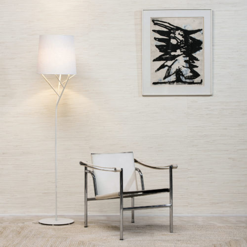 Chrome chair and standing lamp, jute weave wallcovering in a shade of pale. Black and beige painting.