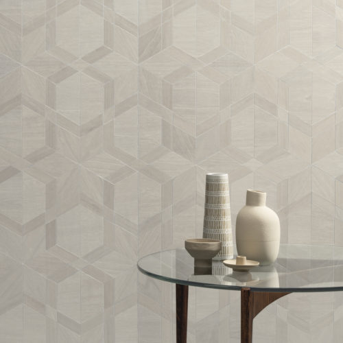 This picture shows a detail of the white and beige Cubist design from the Sycamore collection by Omexco. Sycamore is an exclusive collection of wood veneer wallcoverings to dress your walls in tactile beauty.