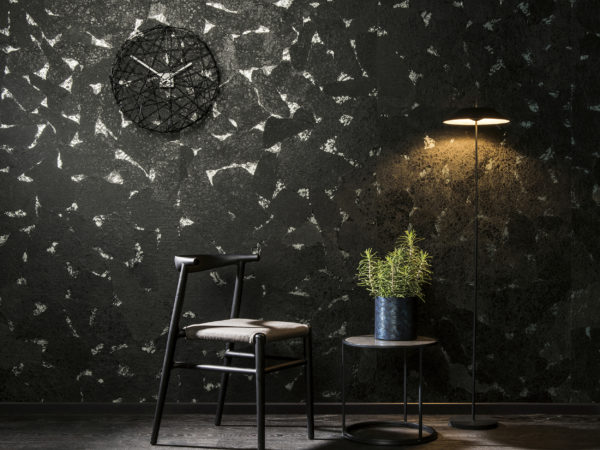 Tactile interior with a lot of black and a few lights on collage of japanese paper from the Collages range by Omexco.
