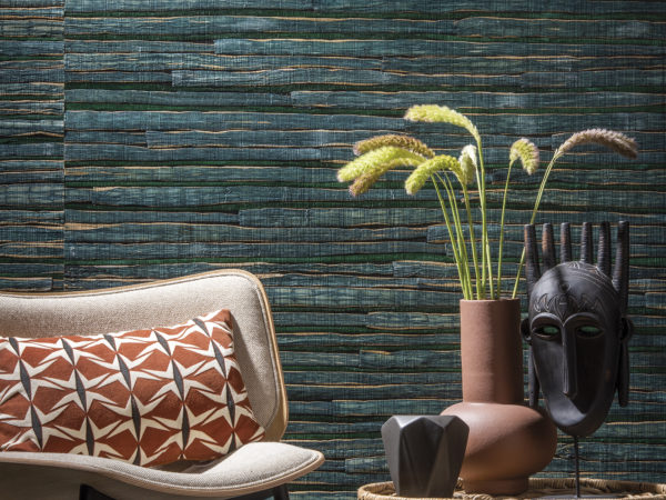 Omexco Seraya woven waterlily: the waterlily is a delightful aquatic plant that absorbs natural dyes beautifully. Malachite green and orpiment yellow fill interiors with intense colour.