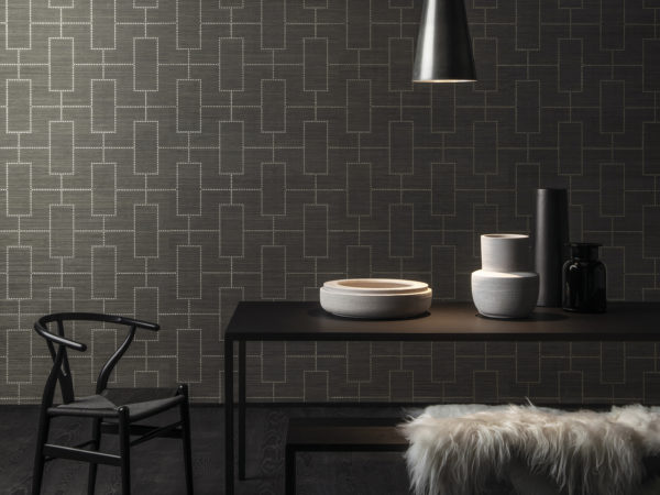 For this design we've lasered a dotted pattern on an abaca wallcovering. The silver dots create a stunning room. Here combined with a Wegner Wishbone chair.