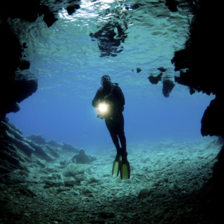 Diver in an Underwater Cave