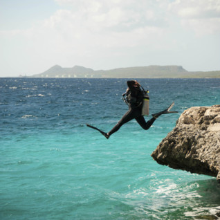 Diver jumping into water