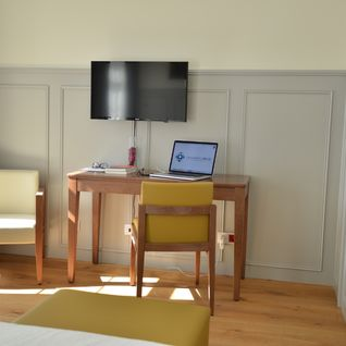 Standard bedroom with tv and desk