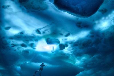 Freediving under ice, Greenland by Alex Dawson