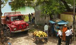 Fruit seller by jetty