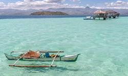 Boat in clear blue water