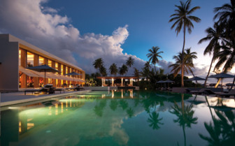Exterior at night at Park Hyatt Hadahaa, luxury hotel in the Maldives