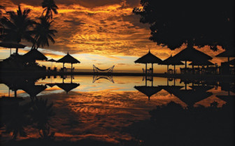 Picture of the sunset across the pool at Desroches Island Resort