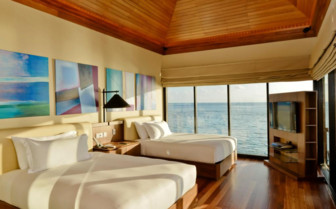 Large bedroom at Huvafen Fushi, luxury hotel in the Maldives