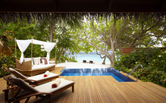 The pool deck at Baros Maldives