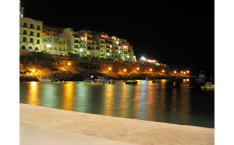 Picture of the view of Xlendi at night from Hotel San Andrea