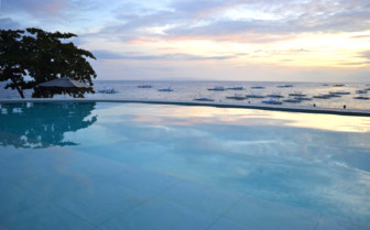 Picture of the Sunset over the Pool at Amorita Resort