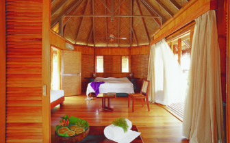Picture of a villa bedroom at Tikehau Pearl Beach Resort