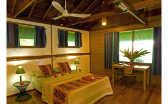 Picture of a bedroom at Walindi Plantation Resort
