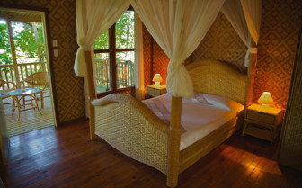 Picture of a bedroom at Tufi Dive Resort