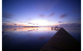 Picture of the sunrise over the pontoon at Southern Cross Club